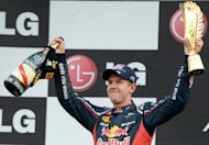 Sebastian Vettel lifts the trophy and a bottle of champagne on the podium after winning the Korean Grand Prix on October 14. He heads into the last four races of the season knowing the momentum is with him and the fate of the championship in his hands after a commanding win in South Korea