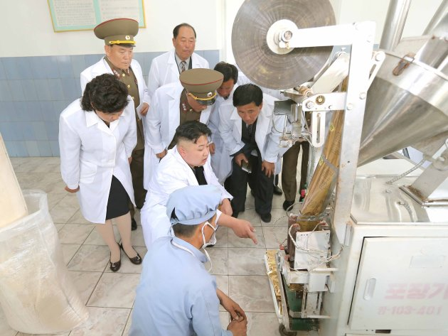 KCNA picture shows North Korean leader Kim Jong-un visiting a foodstuff processing factory under the Korean People's Army Unit 534