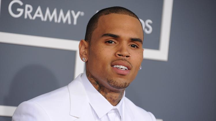 FILE - In this Feb. 10, 2013 file photo, Chris Brown arrives at the 55th annual Grammy Awards, in Los Angeles. Brown is due back in a Los Angeles courtroom on Wednesday, Nov. 20, 2013, to update a judge on his progress on completing community service ordered in an assault case filed after his 2009 attack on Rihanna. It will be Brown's first court appearance in LA since his arrest for misdemeanor assault in Washington, D.C. (Photo by Jordan Strauss/Invision/AP, File)