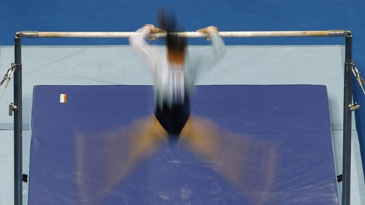 Gymnast competes during the artistic gymnastics women's all-around final match at the 2014 Nanjing Youth Olympic Games in Nanjing,