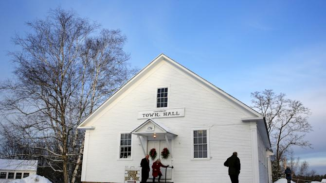 People are seen at polling place at the Canterbury Town Hall polling station in Canterbury, New Hampshire