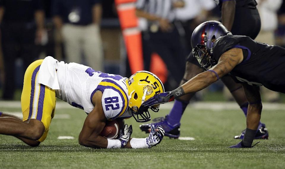 LSU's James Wright (82) recovers a fumble on the kick off against TCU's Brandon Carter (3) during the first half of an NCAA college football game on Saturday, Aug. 31, 2013, in Arlington, Texas. (AP Photo/LM Otero)