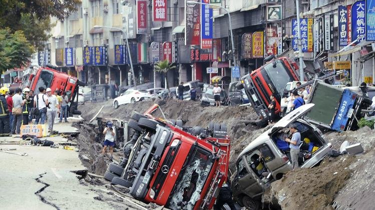Rescue personnel survey the wreckage after an explosion in Kaohsiung, southern Taiwan