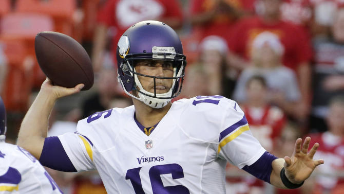 Minnesota Vikings quarterback Matt Cassel throws a pass against the Kansas City Chiefs during the first half of an NFL preseason football game in Kansas City, Mo., Saturday, Aug. 23, 2014. (AP Photo/Charlie Riedel)