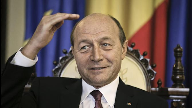 Romanian President Traian Basescu gestures during an interview with the Associated Press in Bucharest, Romania, Thursday, March 7, 2013.  Romania's president says that the country should do more to tackle corruption if it wants to join the European Union's open border area, known as the Schengen Area. Basescu said that joining the so-called Schengen Area should become a national priority for the country of 19 million which joined the European Union in 2007. The Schengen Area is named after the town in Luxembourg where the open border agreement was signed. (AP Photo/Vadim Ghirda)