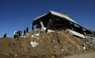 "Palestinians inspect the ruins of the home they lost during Israel's ""Cast Lead"" Gaza offensive in 2009. An Israeli soldier implicated in the killing of two Gaza women carrying a white flag during faces a 45-day jail term under a plea bargain approved by a military court, local media said. (AFP Photo/Mahmud Hams)"