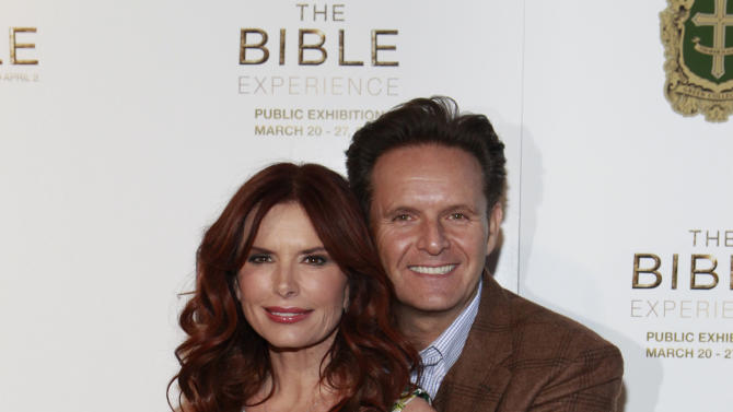 IMAGE DISTRIBUTED FOR FOX HOME ENTERTAINMENT - Producer and Actress Roma Downey and Producer Mark Burnett  pose on the red carpet to celebrate the April 2 Blu-ray, DVD, and Digital HD release of THE BIBLE from Twentieth Century Fox Home Entertainment at The Bible Experience, a rare exhibit of biblical artifacts, on Tuesday, March 19, 2013, in New York. (Photo by Mark Von Holden/Invision for Fox Home Entertainment/AP Images)
