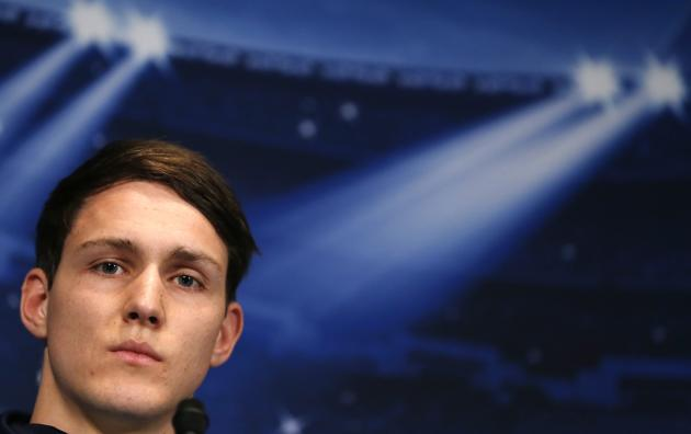 Bayer Leverkusen's Philipp Wollscheid addresses a news conference at the Parc des Princes stadium in Paris