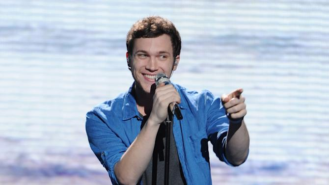 """In this May 9, 2012 photo released by Fox, contestant Phillip Phillips performs on the singing competition series """"American Idol,"""" in Los Angeles. (AP Photo/Fox, Michael Becker)"""