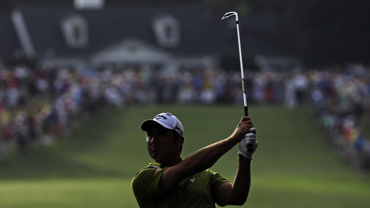Trevor Immelman, of South Africa, watches his second shot on the first fairway during the second round of the Masters golf tournament Friday, April 12, 2013, in Augusta, Ga. (AP Photo/David J. Phillip)