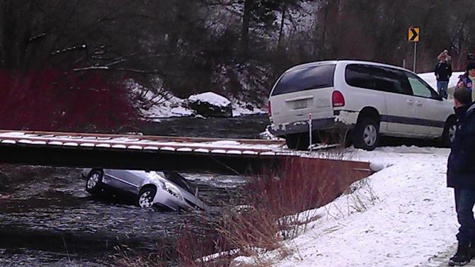 This photo provided by Chris Willden shows a car in the Logan River in Utah Saturday, Dec. 31, 2011, after it was flipped upright by rescuers who saved three children trapped inside.  The car had plunged off an embankment into the river and Willden shot out the car's window with a handgun and cut a seat belt to help free the children after the accident. (AP Photo/Chris Willden)