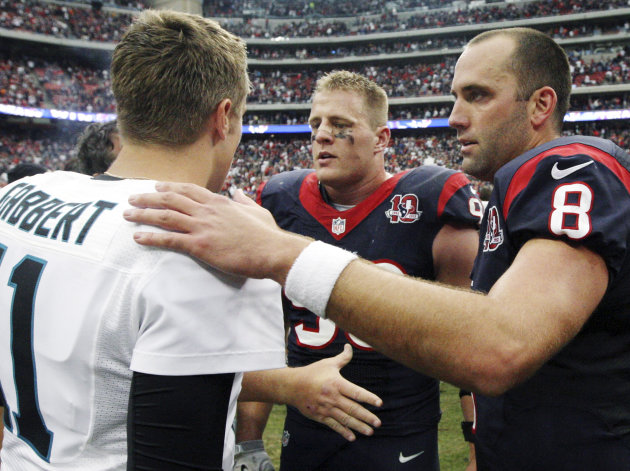 Jacksonville Jaguars quarterback Blaine Gabbert (11) greets Houston Texans quarterback Matt Schaub (8) and J.J. Watt (99) after the Texans defeated the Jaguars 43-37 in overtime of an NFL football gam