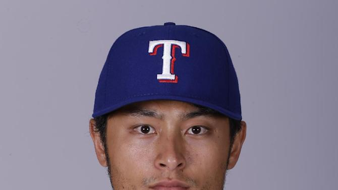This is a 2015 photo of Yu Darvish of the Texas Rangers baseball team. This image reflects the Texas Rangers active roster as of Monday, March 2, 2015, when this image was taken. (AP Photo/Charlie Riedel)