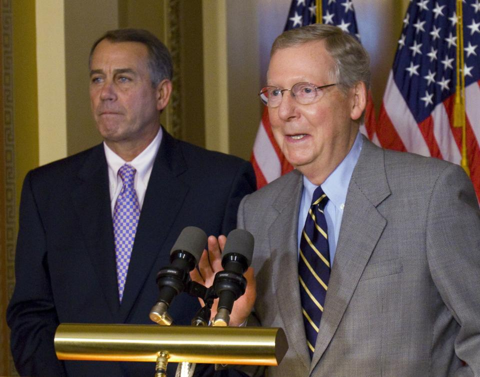 House Speaker John Boehner, R-Ohio, and Senate Minority Leader Mitch McConnell, R-Ky., speak at a news conference on Capitol Hill in Washington, Saturday, July 30, 2011.(AP Photo/Harry Hamburg)