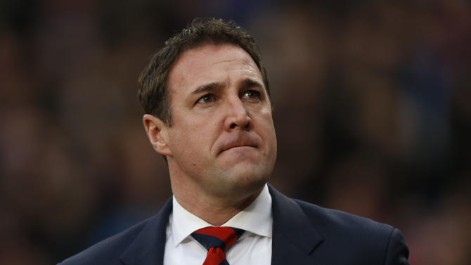 Cardiff City's manager Malky Mackay arrives at the dugout before the start of their English Premier League soccer match against Crystal Palace at Selhurst Park, London, Saturday, Dec. 7, 2013