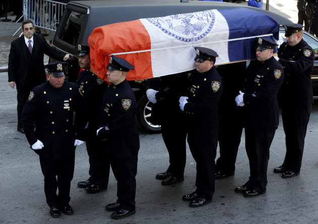 A casket containing the remains of former New York City Mayor Ed Koch is brought into Temple Emanu-El, at for his funeral in New York, Monday, Feb. 4, 2013. The crowd braved temperatures in the low 20