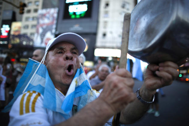 A protester bangs a pot during a march against Argentina's President Cristina Fernandez in Buenos Aires, Argentina, Thursday, Nov. 8, 2012. Angered by rising inflation, violent crime and high-profile