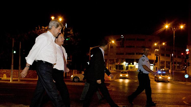 U.S. Secretary of State John Kerry, left, with Frank Lowenstein, senior advisor to the secretary on Middle East issues, return their hotel just after 4 a.m. on Sunday, June 30, 2013 after finishing a meeting with Prime Minister Netanyahu that took over six hours. After the marathon meeting, Kerry decided to get some air by walking to a park near the hotel where he is staying and the meeting was held. Kerry is shuttling between Palestinian and Israeli leaders in hopes of restarting peace talks. (AP Photo/Jacquelyn Martin, Pool)