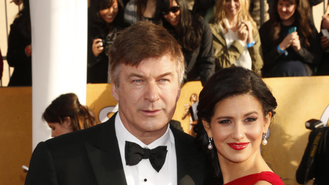 Alec Baldwin and Hilaria Thomas arrive at the 19th Annual Screen Actors Guild Awards at the Shrine Auditorium in Los Angeles on Sunday Jan. 27, 2013. (Photo by Todd Williamson/Invision for The Hollywood Reporter/AP Images)