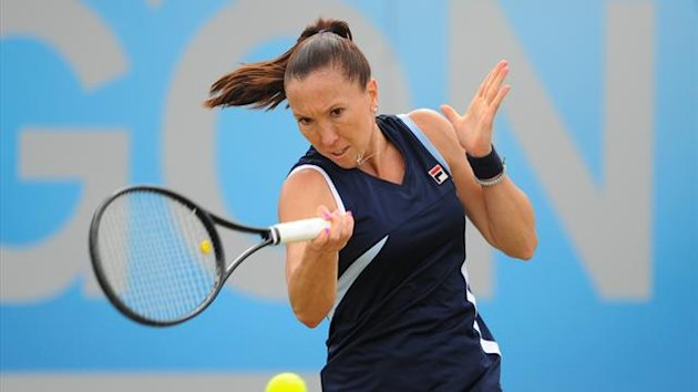 TENNIS Serbia's Jelena Jankovic in action against Japan's Misaki Doi during their quarter final match