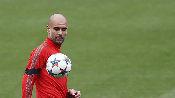 The Latest: Pep goes home to Barca