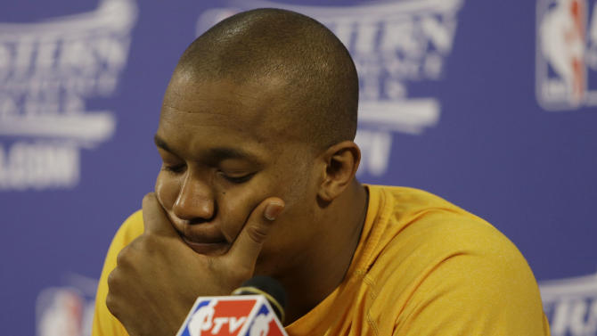 Indiana Pacers David West  pauses during the post game news conference following  Game 7 in their NBA basketball Eastern Conference finals playoff series against the Miami Heat, Tuesday, June 4, 2013 in Miami. The Heat defeated the Pacers 99-76 to advance to the NBA finals against the San Antonio Spurs. (AP Photo/Lynne Sladky)