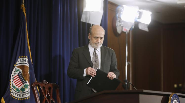 U.S. Federal Reserve Chairman Bernanke takes his seat for his final planned news conference before his retirement, at the Federal Reserve Bank headquarters in Washington