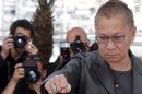 "Director Takashi Miike poses during a photocall for the film ""Wara No Tate"" at the 66th Cannes Film Festival in Cannes"