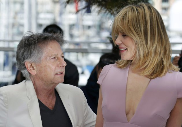 "Director Roman Polanski poses with his wife and cast member Emmanuelle Seigner during a photocall for the film ""La Venus a la Fourrure"" at the 66th Cannes Film Festival"