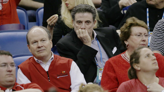 Louisville men's head coach Rick Pitino watches action between Connecticut and Louisville during first half of the national championship game of the women's Final Four of the NCAA college basketball tournament, Tuesday, April 9, 2013, in New Orleans. (AP Photo/Dave Martin)