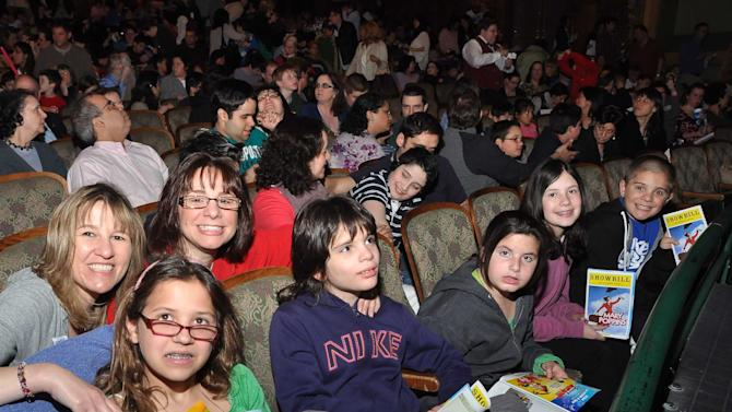 "In this April 29, 2012 photo released by the Theatre Development Fund, kids attend at an autism-friendly performance of the musical ""Mary Poppins, in New York. About 40 autism specialists _ many master's students at Hunter College, special education experts or social workers _ roamed the theater, providing comfort and help to families. (AP Photo/Theatre Development Fund, Anita & Steve Shevett)"