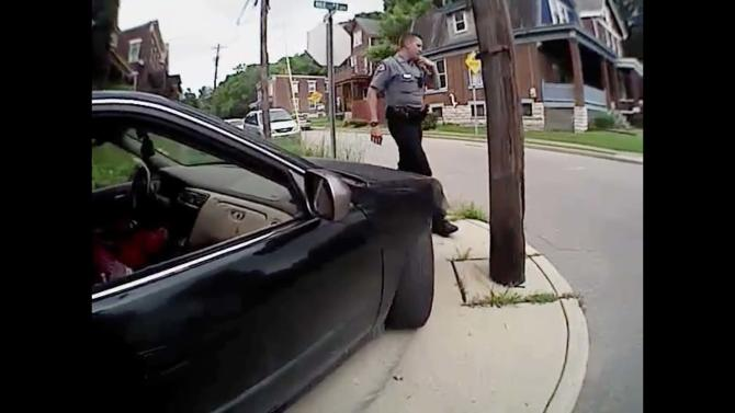 Body cam video shows University of Cincinnati police officer Ray Tensing standing near Dubose vehicle in Cincinnati