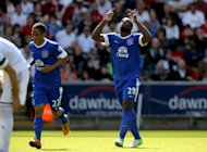 Victor Anichebe, right, celebrates scoring his side's first goal