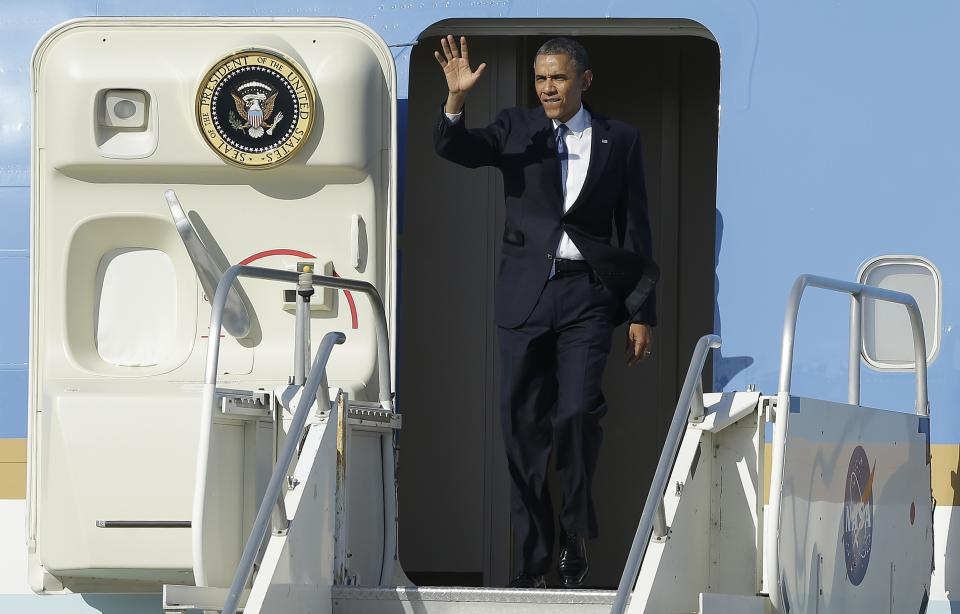 President Barack Obama waves as he arrives on Air Force One at Moffett Federal Airfield in Mountain View, Calif., Thursday, June 6, 2013. (AP Photo/Jeff Chiu)