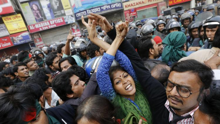 Activists chant slogans during a rally before trying to surround and block access to the High Commission of Pakistan for the second day in Dhaka