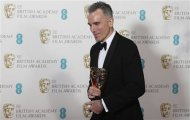 Daniel Day-Lewis celebrates after winning the Best Actor award for &quot;Lincoln&quot; at the British Academy of Film and Arts (BAFTA) awards ceremony at the Royal Opera House in London February 10, 2013. REUTERS/Suzanne Plunkett