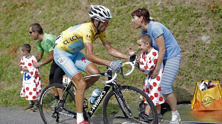 Italy's Vincenzo Nibali, wearing the overall leader's yellow jersey, climbs towards Hautacam to win the eighteenth stage of the Tour de France cycling race over 145.5 kilometers (90.4 miles) with start in Pau and finish in Hautacam, Pyrenees region, France, Thursday, July 24, 2014. (AP Photo/Laurent Cipriani)