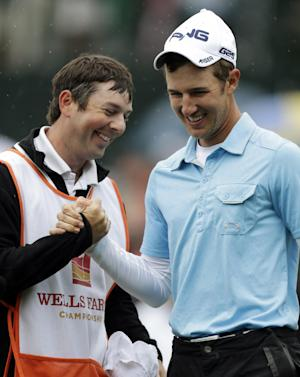 Derek Ernst, right, is congratulated by his caddie Aaron Terry, left, after winning the Wells Fargo Championship golf tournament at Quail Hollow Club in Charlotte, N.C., Sunday, May 5, 2013. (AP Photo/Bob Leverone)