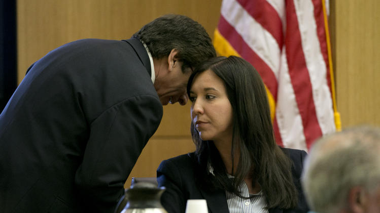 Prosecutor Juan Martinez whispers ion the ear of Dr. Janeen DeMarte an ...