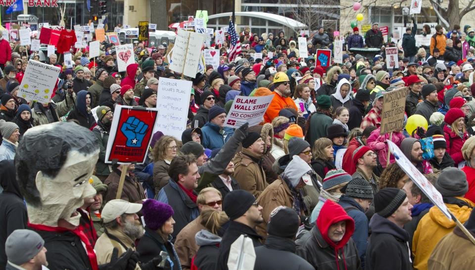 Crowds listen as Michael Moore makes a speech  at the state Capitol in Madison, Wis., Saturday, March 5, 2011, on the 18th day of protests over the governor's proposed budget that would eliminate collective bargaining rights for many state workers. (AP Photo/Andy Manis)