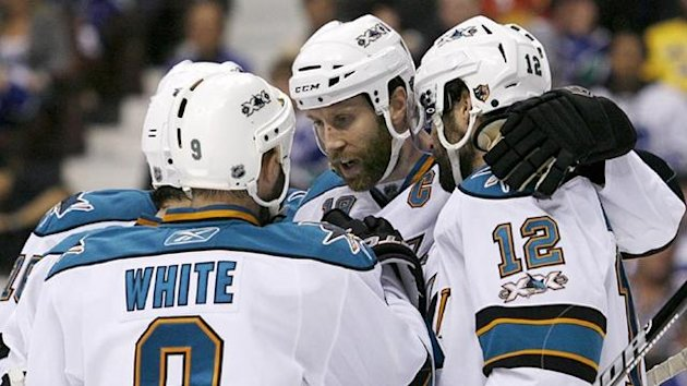 2011-12 San Jose Sharks Joe Thornton (C) congratulates teammate Patrick Marleau (12)