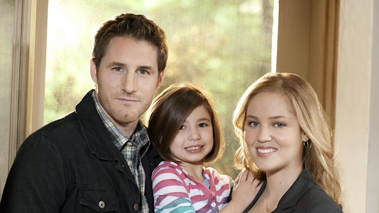 "Sam Jaeger as Joel Graham, Savannah Rae as Sydney Graham, and Erika Christensen as Julia Braverman-Graham in ""Parenthood."""