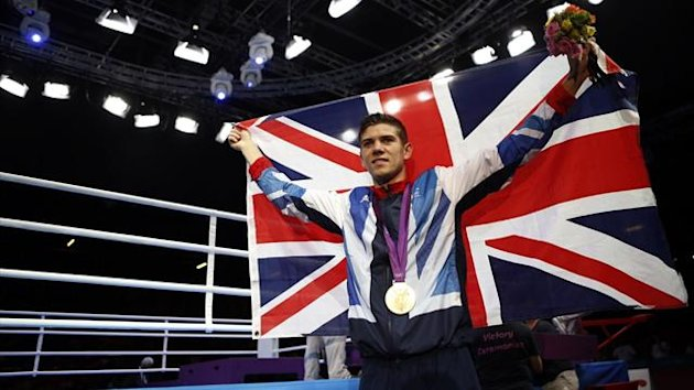 Luke Campbell of Britain celebrates with his boxing gold medal (Reuters)