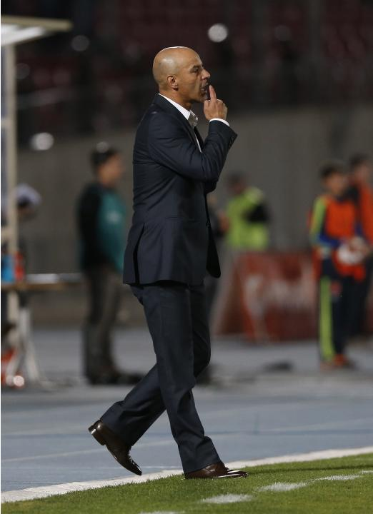 Chile's Universidad de Chile head coach Marco Antonio Figueroa shouts to his players during their Copa Sudamericana soccer match against Argentina's Lanus in Santiago