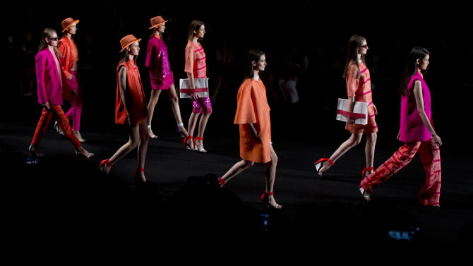 Models wear creations from the Sacada summer collection in Rio de Janeiro, Brazil, Wednesday, April 17, 2013. The city is holding its annual Fashion Rio events. (AP Photo/Felipe Dana)