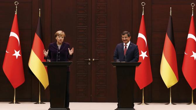 German Chancellor Merkel gestures during a news conference in Ankara
