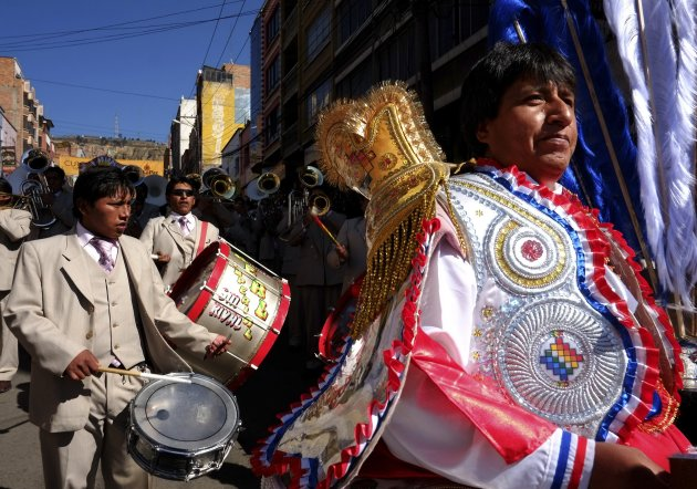"Dancers of the Morenada group participate in a parade to honor the ""Lord of Great Power"" saint in La Paz"