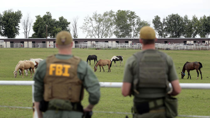 FILE - In this June 12, 2012 file photo, FBI agents overlook a horse ranch under investigation in Lexington, Okla. A federal judge in Texas sentenced Jose Trevino Morales, the brother of two Mexican cartel leaders to 20 years in prison on Thursday, Sept. 5, 2013, for running a money laundering operation from a sprawling horse ranch in Oklahoma. Sentencing is also expected for Francisco Antonio Colorado Cessa, Fernando Solis Garcia, Eusevio Maldonado and Raul Ramirez, who pleaded guilty in April to a lesser money laundering charge. (AP Photo/Brett Deering, File)