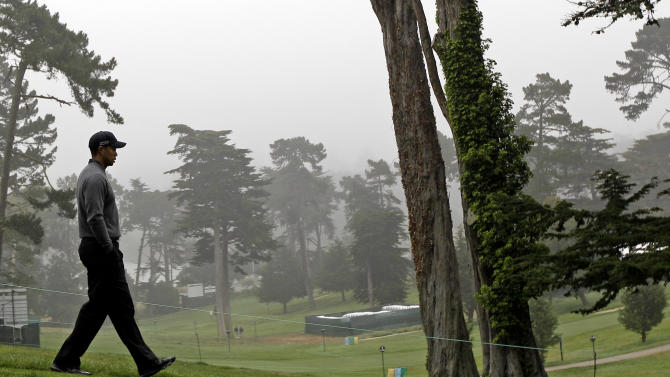 Tiger Woods makes his way down the ninth hole during a practice round for the U.S. Open Championship golf tournament Wednesday, June 13, 2012, at The Olympic Club in San Francisco. (AP Photo/Eric Gay)