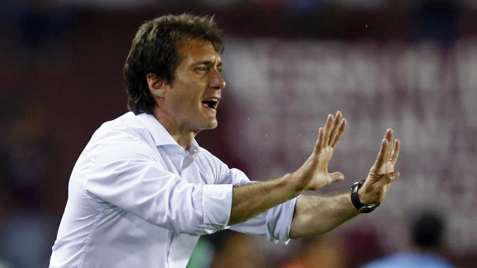 Barros Schelotto, head coach of Argentina's Lanus, reacts during their Copa Sudamericana soccer match against Paraguay's Cerro Porteno in Buenos Aires
